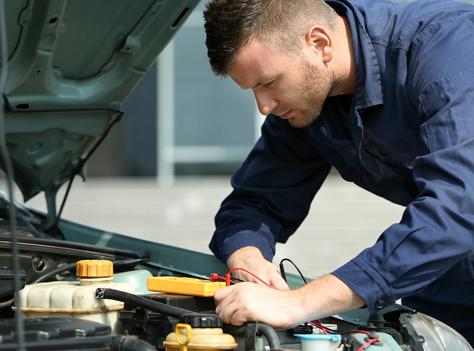 Mechanic servicing a vehicle - Skoda Servicing Slough